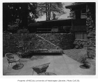Edes residence exterior showing patio, Hunts Point, ca. 1955.