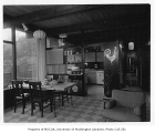 Baker residence interior showing dining area and kitchen, Seattle, 1955
