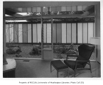 Blakeley Clinic interior showing seating area and landscaping, Seattle, 1957