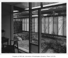 Blakeley Clinic interior showing view of garden, Seattle, 1957