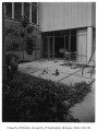 Hauberg residence exterior showing patio, Seattle, 1957