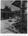 Clark residence exterior showing patio, Seattle, 1957