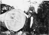 Dick Finnell, local logger, standing by large old-growth log. 1923