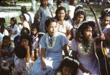 Native women and children with guitar, Likiep Atoll, August 20, 1949