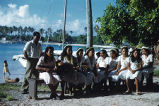 Native women sitting in a group playing guitars, Likiep Atoll, August 20, 1949
