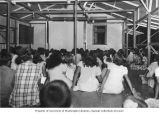 Marshallese children gathered in the Catholic Mission on Likiep Atoll for a movie night, August...