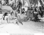 Group of Rongerik Island natives waiting for food to be distributed by Captain Engleman, summer...