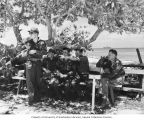 Group from the Bikini Atoll Radiological Survey taking a break in the shade with USS CHILTON in...