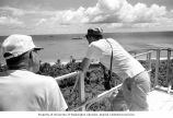 Lauren R. Donaldson (left) and Hill Williams on the watch tower on Bikini Island, summer 1964