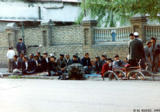 Prayer in front of a mosque during Nawiuz, an Islamic New Year holiday, in Quqon