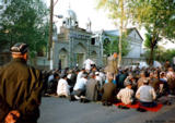 Men praying in front of a mosque during Nawiuz, an Islamic New Year holiday, in Quqon