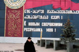 "Mural in Georgian and in Russian,  ""Onward to new achievements, my republic,"" on a..."
