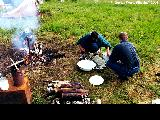 Cooking shishkebab over a campfire near Zheleznogorsk