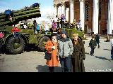 Children climbing on a rocket launcher in front of the Opera and Ballet theater during...