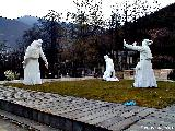 Memorial in Sheki to Azeri victims of genocide, with a cemetery on the hillside in the background