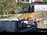 Burning refuse in the backyard of an apartment building in Ulan-Ude