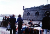 Selling souvenirs in front of the Peter and Paul Fortress on the Neva River in Saint