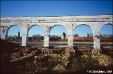 View of the Kremlin and Volkhov River through the arches of a former market in the merchants'...