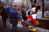Mickey Mouse inviting children to take a picture with him in Rostov-na-donu
