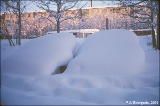 Cars buried by a big snowfall along the main road in Petropavlovsk-Kamchatsky