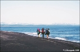 Backpacking geologists on the shore of Ozernoy Bay, southern Bering Sea coast