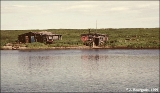 Fishing cabins at the mouth of the Stolbovaya River, south Ozernoy Bay