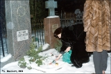 Lighting a candle at the grave of Yury Lotman on Orthodox Christmas Eve in Tartu