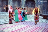 Uzbek folk dance group performing in the Registan Plaza Medressa Shir-Dor, an Islamic school, in...