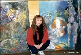 Eva Luik, aTartu artist, in a studio where she teaches painting, among works by her students