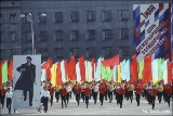Carrying flags and a portrait of Lenin during the May Day parade in Irkutsk