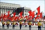 Carrying flags with the portraits of Soviet Leaders during the May Day parade in Irkutsk