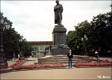 "Monument to Pushkin on Pushkin Square in Moscow with the ""Rossiya"" movie theater in the..."