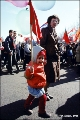 Child carrying a flag during the May Day parade in Irkutsk
