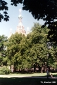 Cathedral of Christ the Savior on the Blood framed by the trees of the Mikhaylovsky Garden, in...