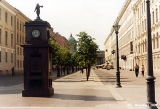 Clock on Malaya Konyushennaya Street with the Kazan Cathedral in in the background,  in Saint...