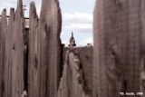 Cupolas of a Russian Orthodox church seen through a wooden fence in Irkutsk