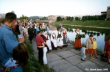 Lithuanians carrying wreaths to the Neris River at the Jonines midsummer festival in Vilnius