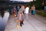 Lighting candles along the Neris River at the Jonines midsummer festival in Vilnius