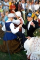 Lithuanians in traditional costumes dancing at the Jonines midsummer festival in Vilnius
