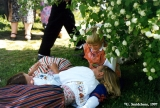 Participants of the Viru Saru International Folk Festival in traditional Estonian costumes resting...