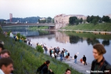 Lithuanians celebrating the Jonines midsummer festival along the Neris River, in Vilnius