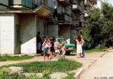Children playing in front of an apartment building in Nakhodka
