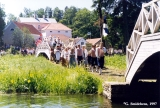 Festival procession along the mill pond at the Viru Saru International Folk Festival in...