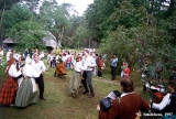 Baltica Folk Festival participants dancing at the ethnographic open-air museum in Riga