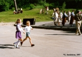 Children rushing to participate in a children's dance at the Folk Festival in Tukums