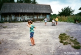 Girl playing with a hula-hoop in the town of Dyatkovo