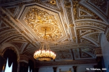 Chandelier on a gilded ceiling in the Winter Palace, Saint Petersburg