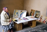Polish woman selling jewelry and icons near the Dawn Gates, an entry into the old city of Vilnius