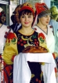 Mordovian woman in a traditional dress offering bread, in Saransk