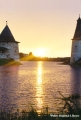 Sunrise on the Velikaya River between two towers of the Pskov fortress